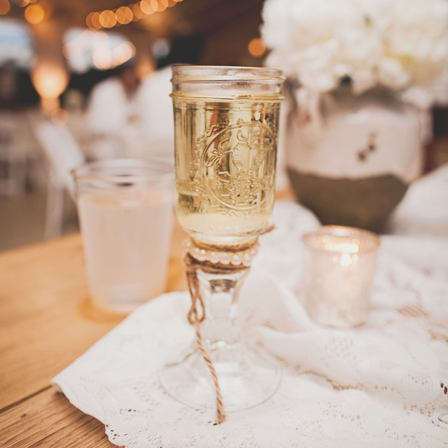 This Mason jar with a stem made for a unique, country-chic wine glass during the reception.
