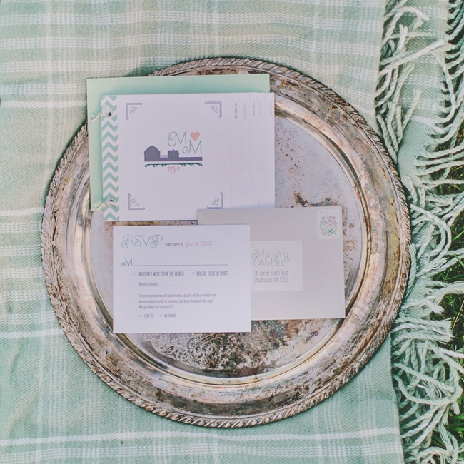 Mallory and Matt's invitation suite featured the silhouette of a barn with their double M initials and a mint chevron design.
