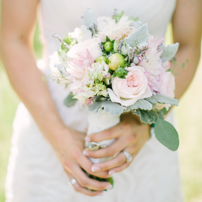 The bride's bouquet was pale pink and white intermixed with light green and featured both buds and blooms.