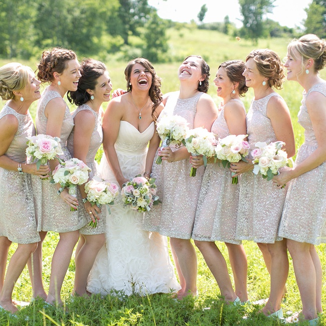 Mallory's bridesmaids wore neutral colored dresses covered in a sheer, shimmering lace layer. The bride's dress was a contemporary rose design from Casablanca.