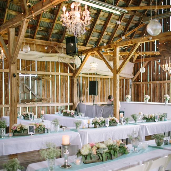 The reception was held at Enchanted Barn in Hillsdale, WI. The couple used the rustic location as a backdrop for their more formal design elements.