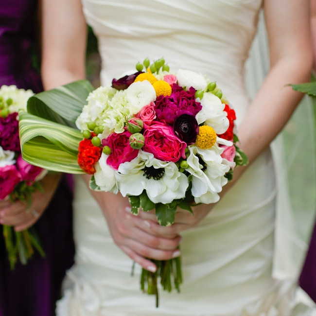 The bridal bouquet featured lots of texture and color with black and white anemone flowers, round yellow billy balls and large folded leaves.