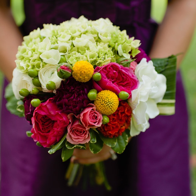 Bridesmaids carried pink, white and yellow bouquets of billy balls, roses and ranunculus down the aisle.