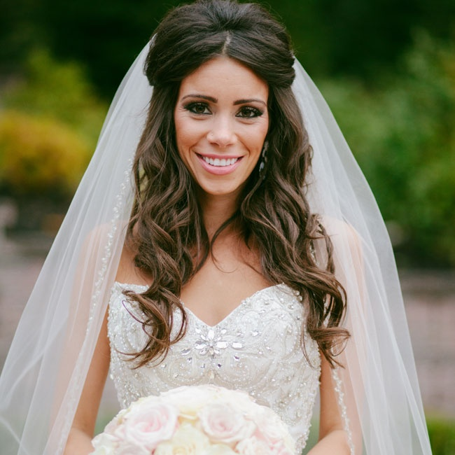 Dina emphasized crystals over flowers- her strapless Stephen Yearick gown, veil and rose bouquet were all embellishing with shimmering rhinestones.