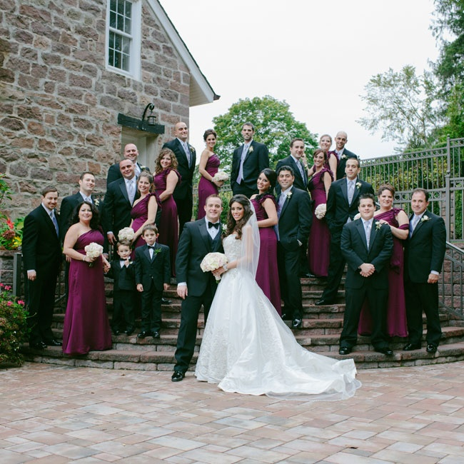 The bridesmaids' one should Jim Hjelm deep purple gowns popped against the groomsmen's refined suits.