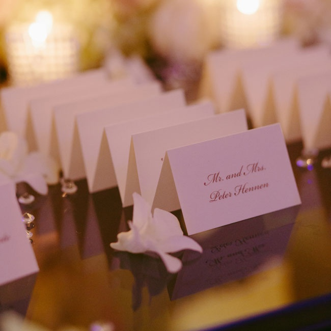 The simple folded escort cards were personalized with a formal black script.