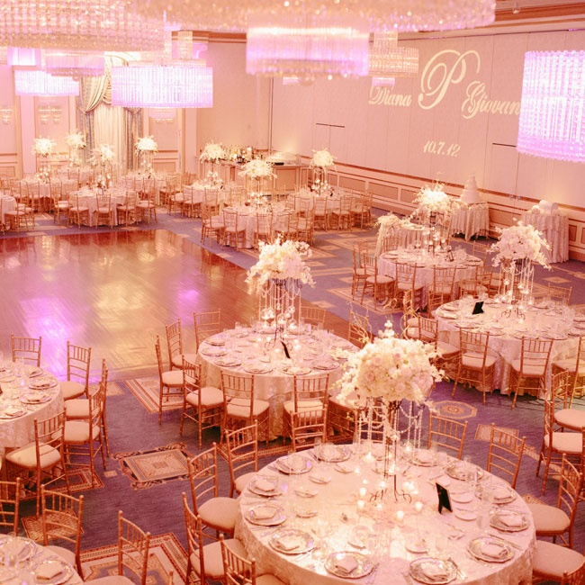 Over-the-top crystal accents and ornate centerpieces with hanging candles were the focal points of the opulent ballroom reception.