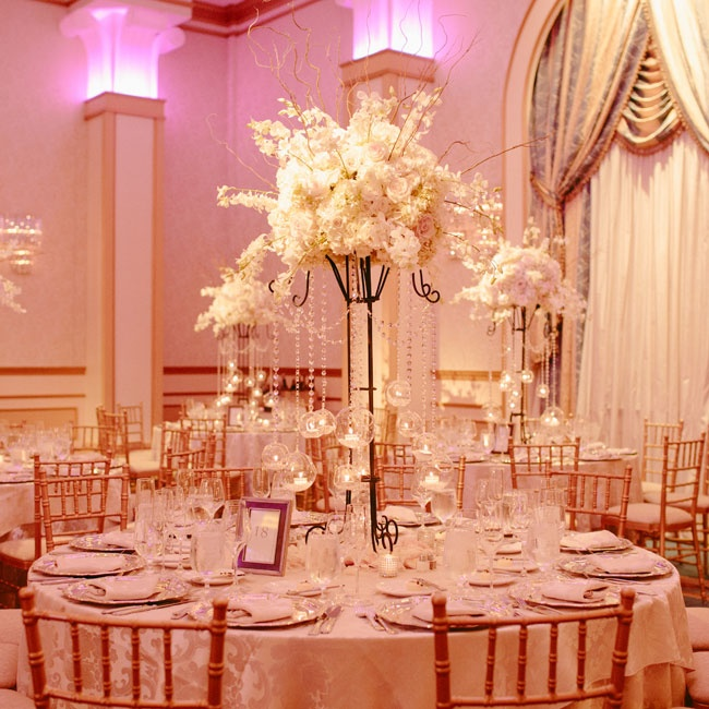 Crystal garlands were draped around the lush high centerpieces with hanging glass bubbles filled with glowing candles.
