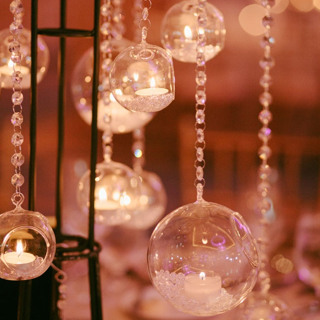 Glass globes infused with crystals and glowing candles added dimension and a classic twist to the tall centerpieces.