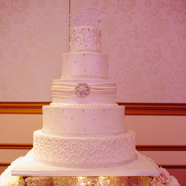 Each tier of the bedazzled white wedding cake featured an array of shimmering crystals.