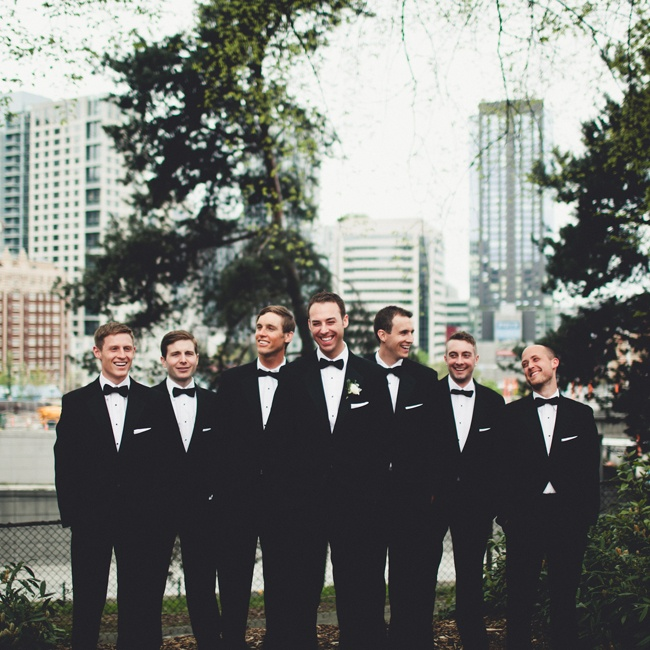 Groomsmen wore traditional black tuxedos with matching black bowties.