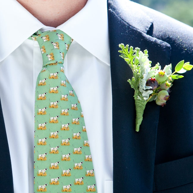 Stuart personalized his look by pairing a green printed tie from Southern Proper with a boutonniere made from blueberries and dusty miller.