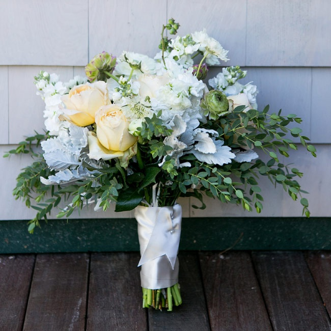 The bride carried a bouquet with a fresh mix of pastel roses, dusty miller, ranunculus and blueberries.