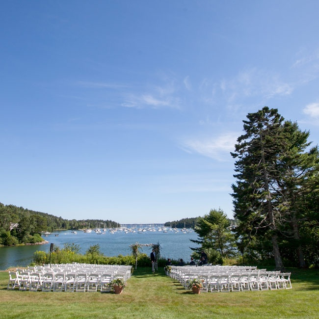 The couple exchanged vows on the waterfront lawn of the Asticou Inn with beautiful views of Northeast Harbor.
