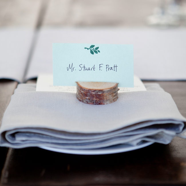Guests were greeted by handmade place cards decorated with Maine blueberries and set in sliced tree branches.