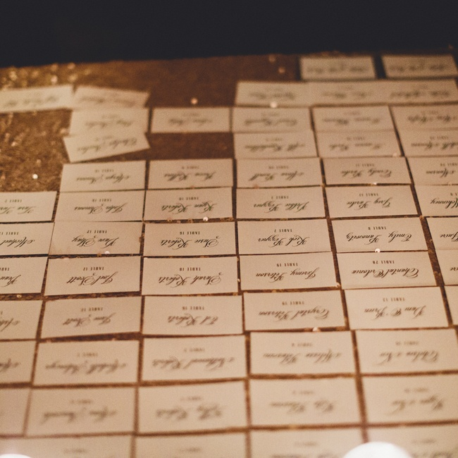 The formal escort cards were laid on a gold sequin tablecloth.