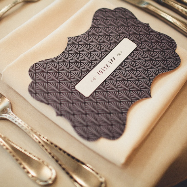 Each guest's place was formally set with an art deco-inspired printed thank you card.