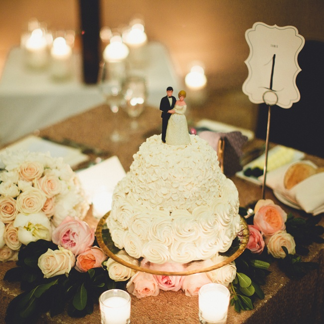 The couple had their own formal, white, two-tiered sweetheart cake made with a vintage bride and groom cake topper.