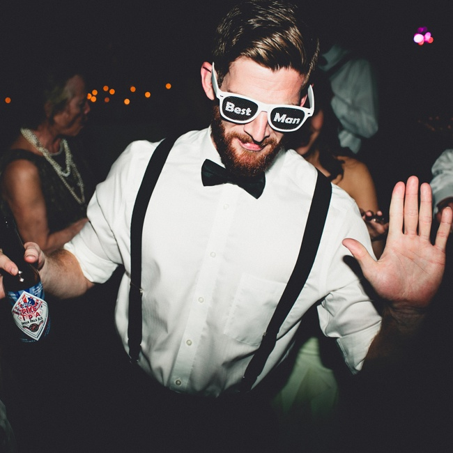 Each member of the wedding party had custom made sunglasses for the dancing portion of the reception denoting their title.