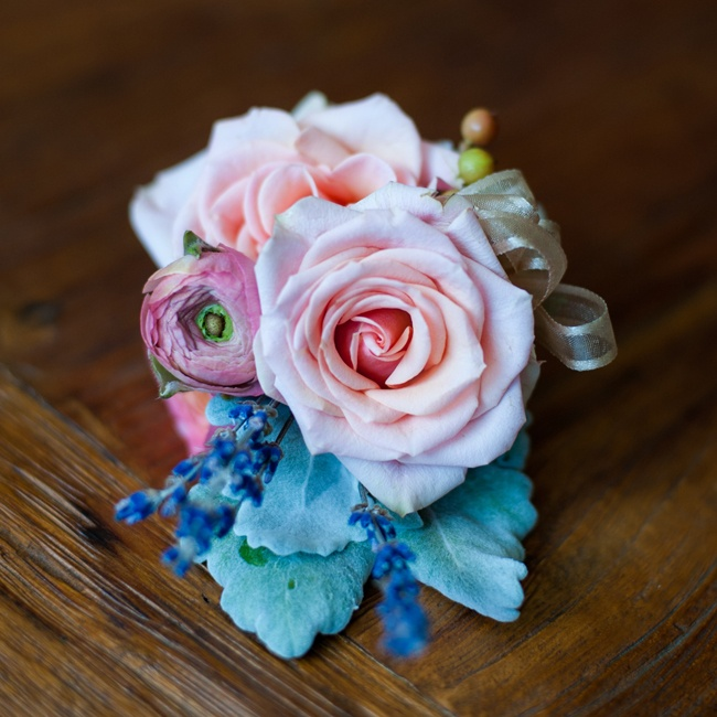 This pink rose and ranunculus corsage was topped off with a few lavender sprigs for a fragrant touch.