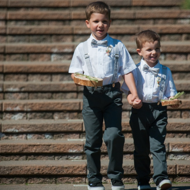 The ring bearers presented Elyssa and Casey's wedding bands on blocks of wood, tied with green ribbon.