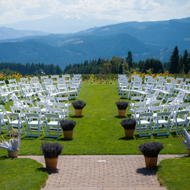 The couple exchanged vows at the center of all their family and friends by arranging their chairs in a circular fashion.