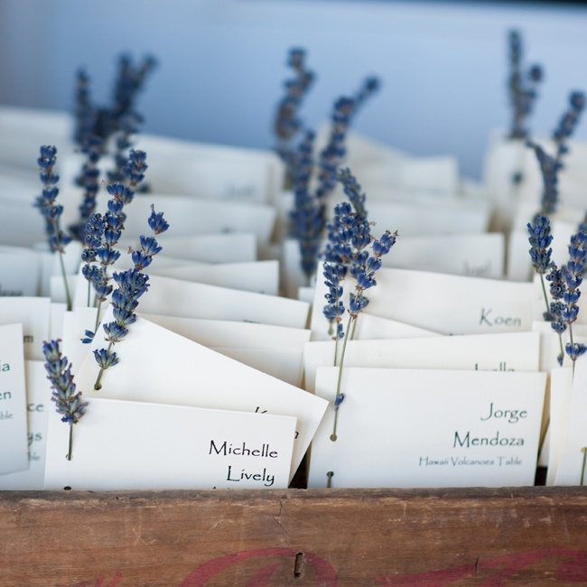 The bride's father designed these escort cards and added a small stem of lavender to each one.