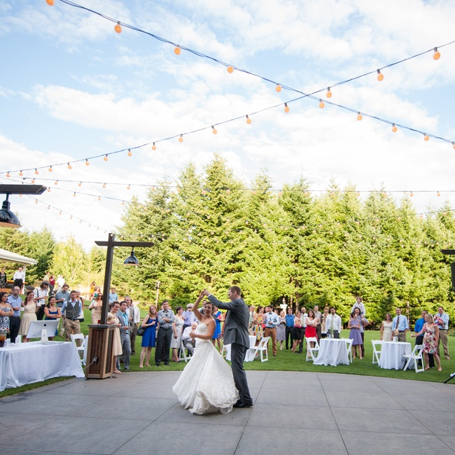 The dancing portion of the reception was an outdoor party decorated with bistro lighting and white tablecloths.