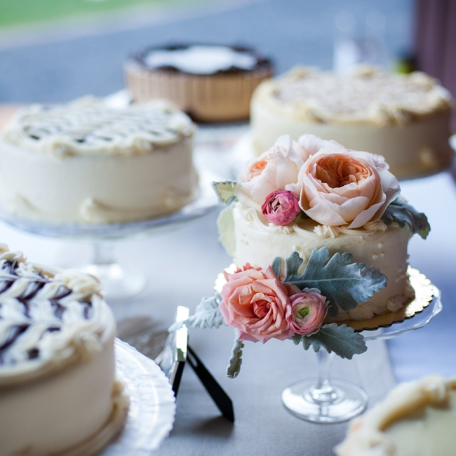Elyssa and Casey had an array of cakes topped with fresh roses and ranunculuses.