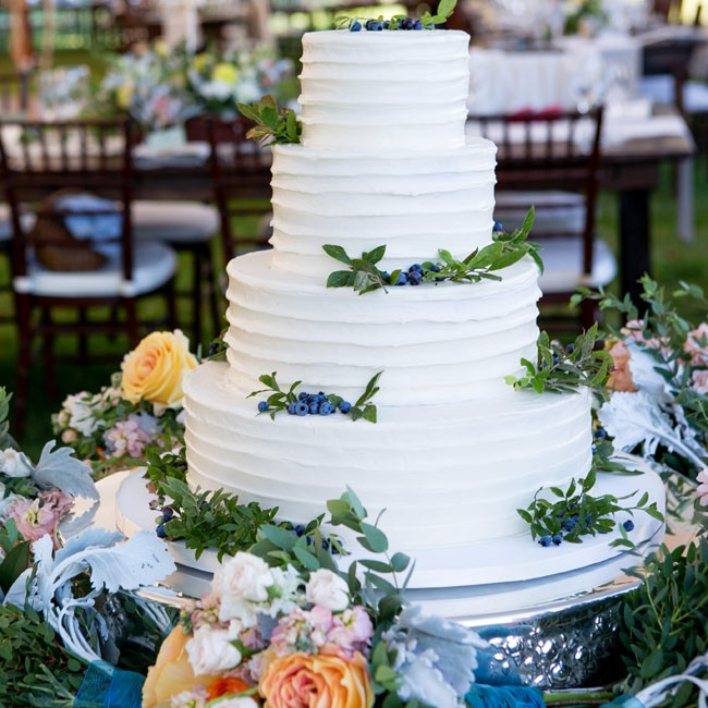 The couple chose a white layer cake with a few simple touches - Maine blueberries and combed frosting.