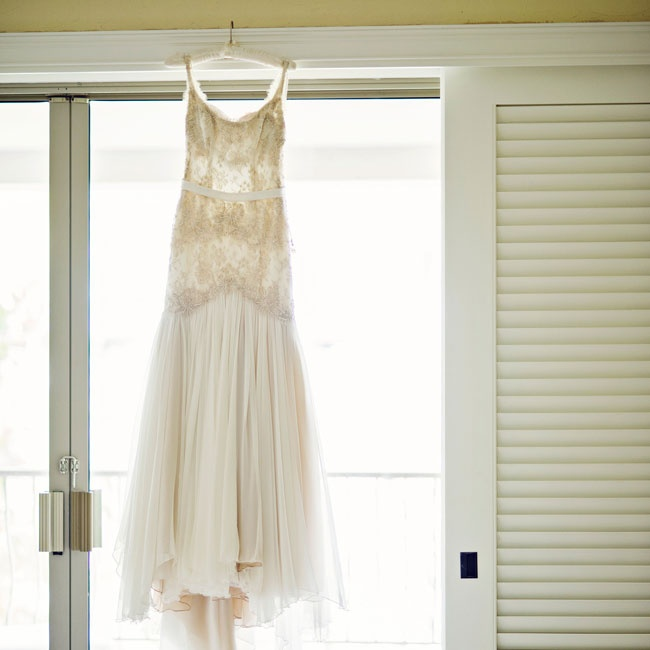 This old Hollywood glam drop waist dress with lace detailing was custom designed by the bride.