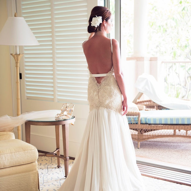 Jessica's romantic gown featured a low back with scalloped detailing.
