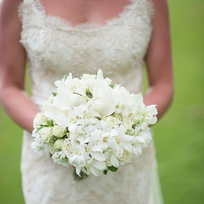 The bride's white bouquet was comprised mostly of white orchids.