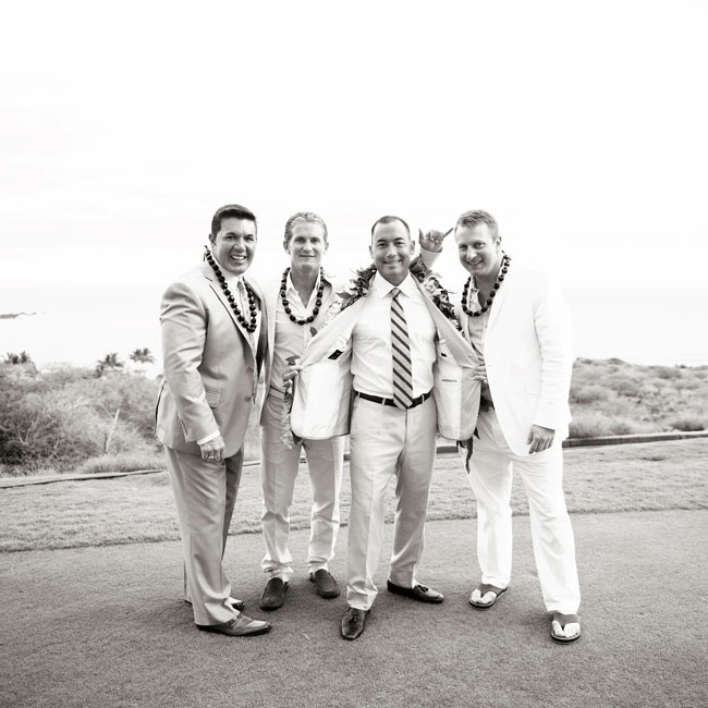 The groomsmen wore light suits in white and tan without ties. One groomsman even wore flip-flops.