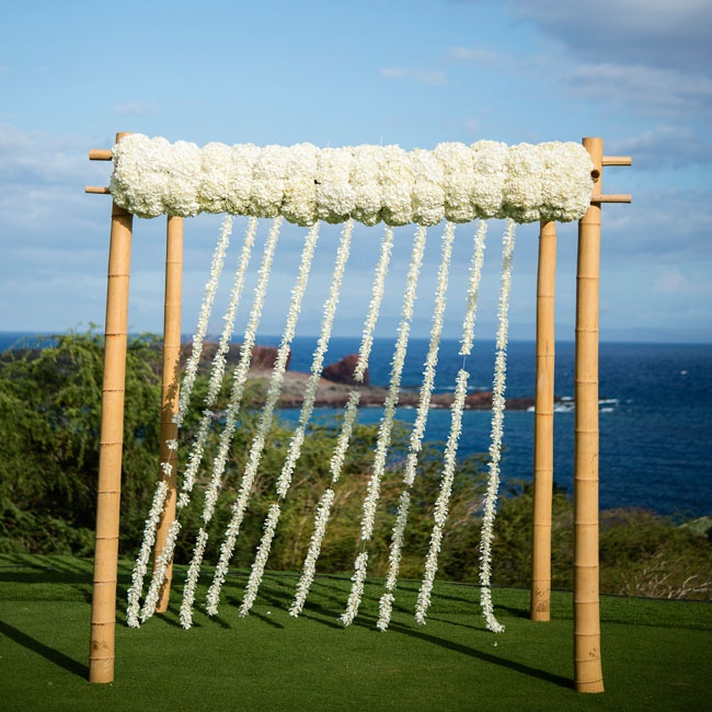 Hydrangeas and hanging garlands of orchids were attached to a bamboo structure for a simple ceremony arch.