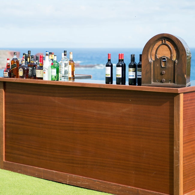 The couple decorated the outdoor bar with a retro dial radio to stay with their vintage vibe.