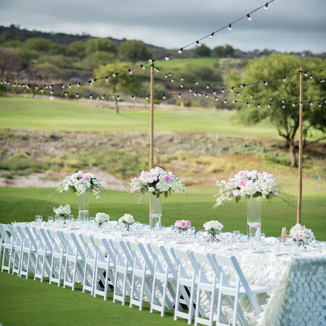 The reception dinner was set on one long table with a white, fish scale patterned tablecloth.