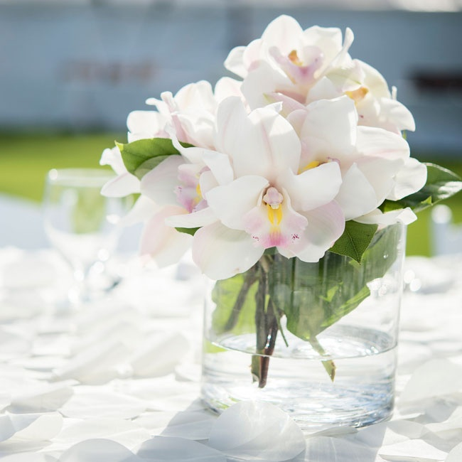 Bouquets of white orchids made simple low centerpieces during the reception.
