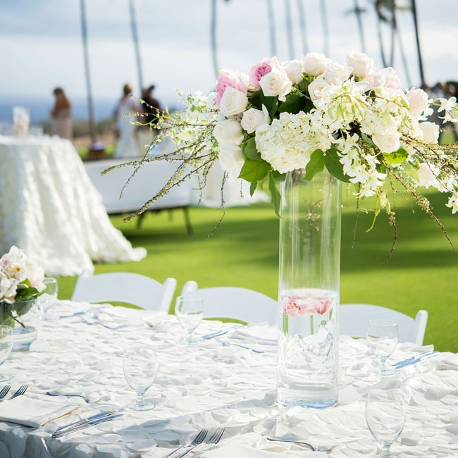 Roses and hydrangeas filled tall glass vases at the reception.
