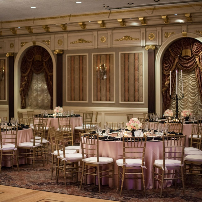 The captivating Parisian-inspired reception featured a blush, black and gold color scheme and delicate rose arrangements.