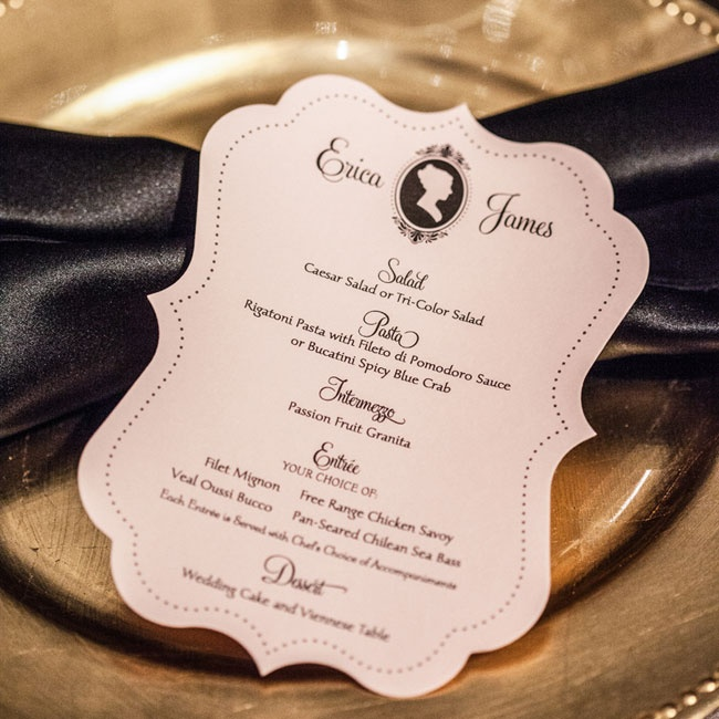 The glamours place settings included gold chargers, black napkins in a bow tie fold fastened with a strand of pearls and vintage-inspired die cut silhouette menus.