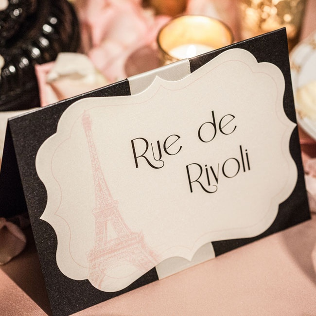 The Paris motif was carried through the reception with Eiffel Tower decor and French table names.