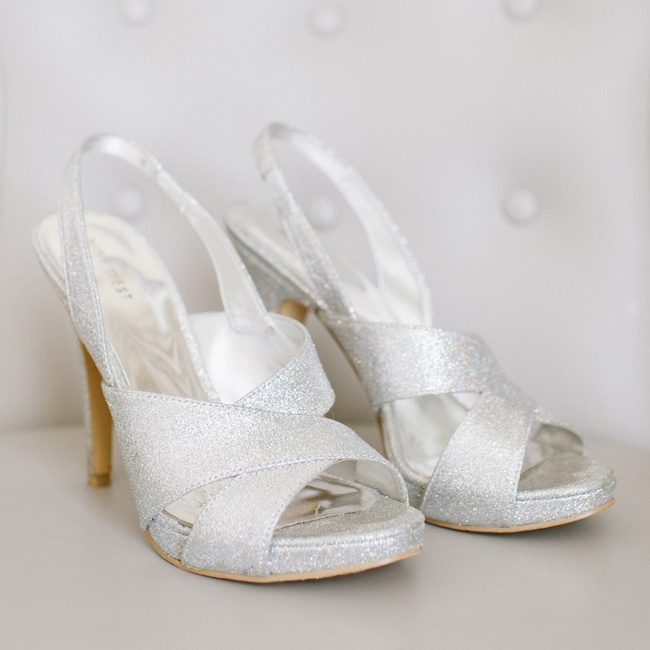 The bride wore these silver, sparkly Nine West heels down the aisle.