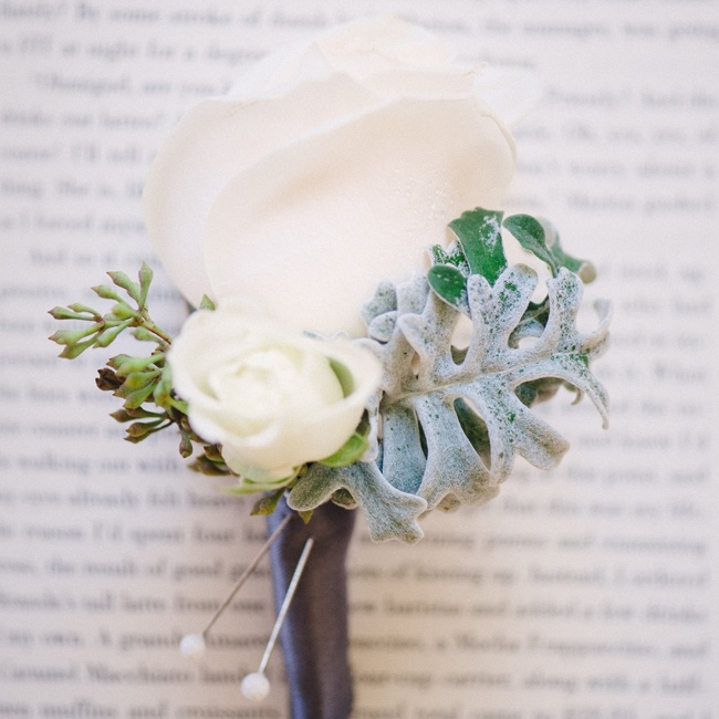 Groomsmen wore white rose boutonnieres accented with dusty miller leaves.