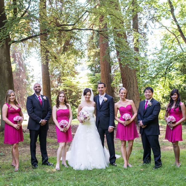 Ada's bridesmaids wore short fuchsia dresses in different styles while groomsmen wore matching fuchsia ties and black suits.