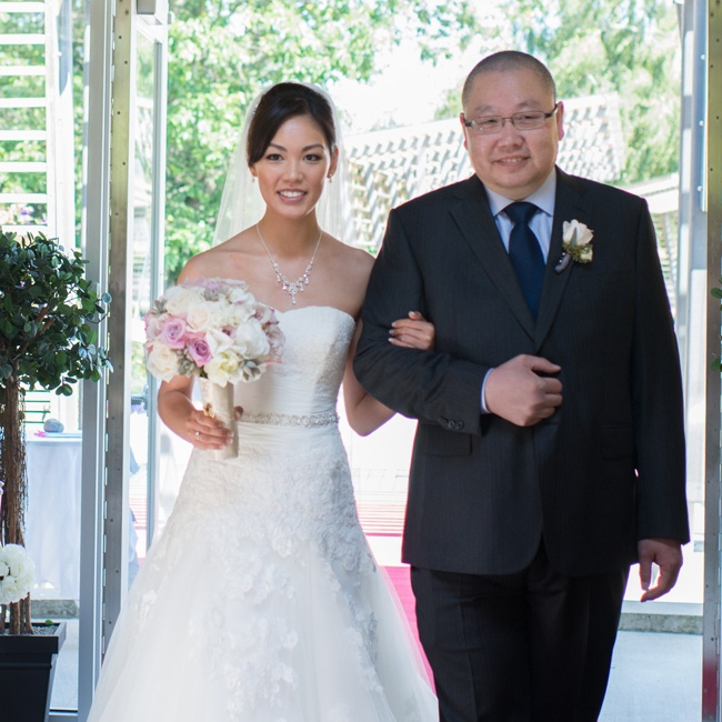 Ada was escorted down the aisle by her father at the Queen Elizabeth Celebration Pavilion in Vancouver.