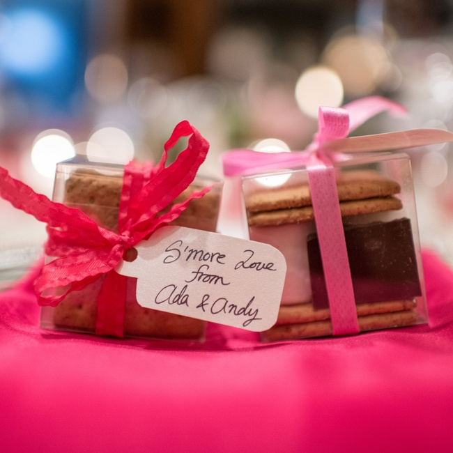 The bride and groom gifted guests with s'more kits tied up with red and pink ribbon.