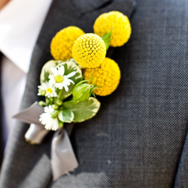 Banjo completed his look with a boutonniere made of Billy balls and daisies which complemented his gray suit.