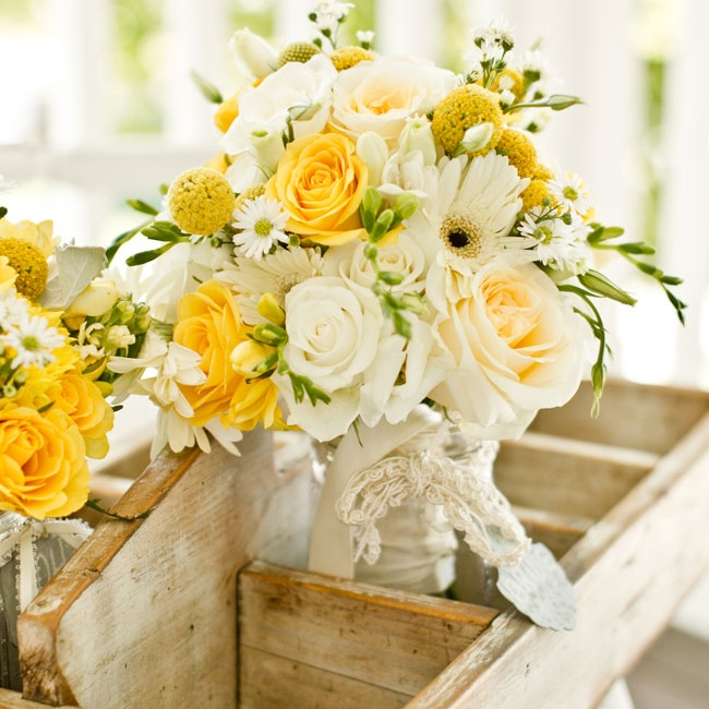 Beverly carried a sunny bouquet filled with roses, gerbera daisies, and craspedia. Satin and lace wrapped the bouquet adding a soft, feminine touch.