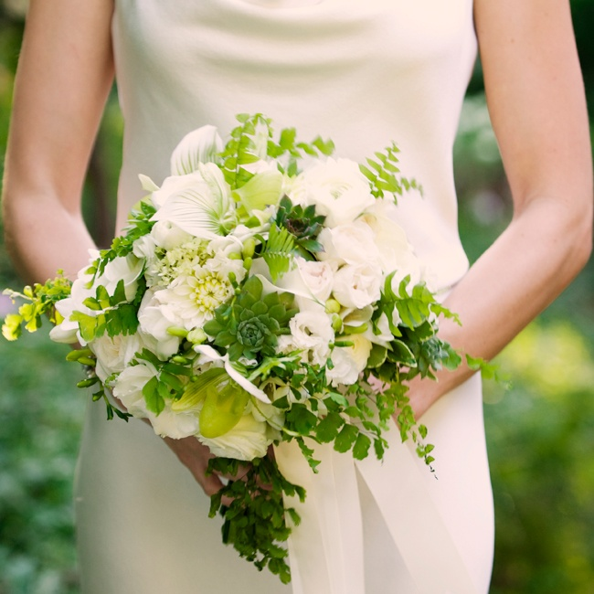 The white and green bridal bouquet was filled with fresh calla lilies, roses, and succulents.